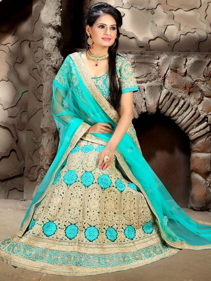Conspicuous net lehenga in turquoise color garnished with heavy zari work. Item Code: GMKI22003 http://www.bharatplaza.com/new-arrivals/lehengas.html