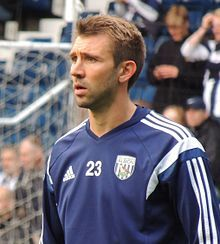 Gareth McAuley warming-up for West Bromwich Albion in 2014.