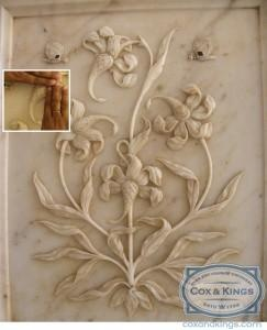 """I found the """"Magic Flower"""" fascinating. This is a marble fresco at the base of a pillar around the Sheesh Mahal, which has a flower carved in such a way that seven unique designs can be seen within it, depending on which part of the panel you hide with your hands. You can see a fish tail, a lotus, a hooded cobra, an elephant's trunk, a lion's tail, a cob of corn and a scorpion. #CoxandKings"""