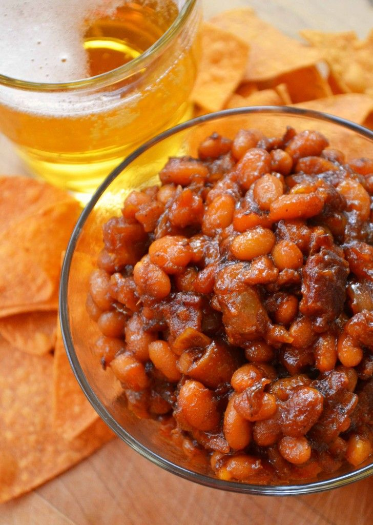 1 – 1.5c beans  6 slices bacon  1 large onion, chopped  1/2c barbecue sauce  1c beer  1/4c brown sugar  1/4c ketchup  2Tbsp. Dijon mustard  1Tbsp. Worcestershire sauce  few drops of hot sauce, or chipotle sauce    Preheat oven to 325°F. In a large pot, cook the bacon  onions over med-high heat for 5-10min, until the bacon is cooked  the onions are soft. Add the beans  rest of ingredients, stir to combine, cover  bake for 2.5hrs, stir (add more liquid if it seems dry) until thickened  saucy