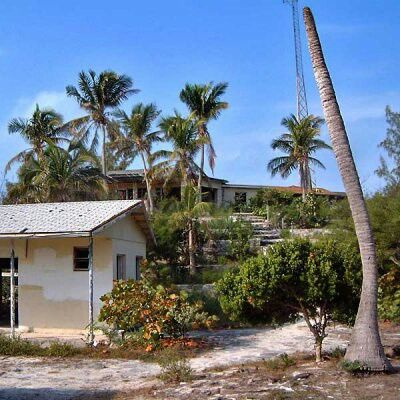 Normans Cay Bahamas the Security Office showen alway's had to rotating guards with machine gun's on 24 hour watch and Carlo's Mansion Above.
