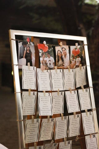 Seat assignments display with wooden frame and clothes pins. ---Philippine Wedding.