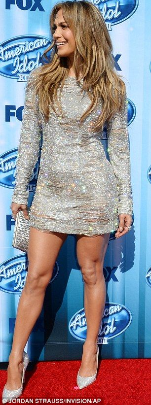 Flashing the flesh: J-Lo looked stunning in her revealing silver dress on Wednesday