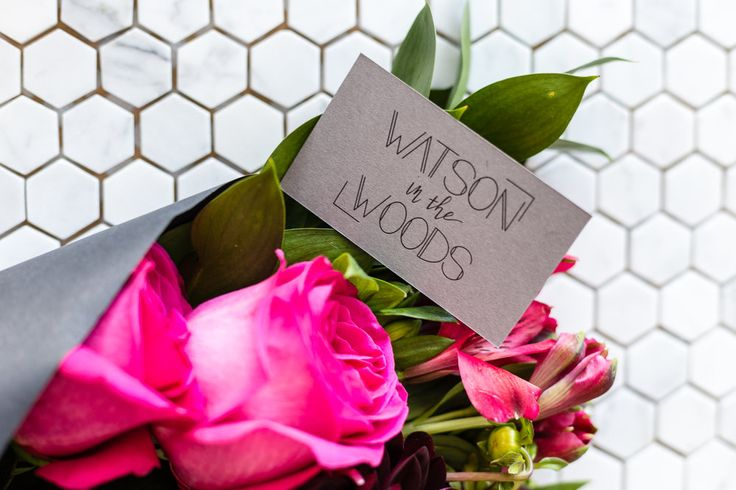 Watson in the Woods. Toronto flower delivery. Deep Pink Posy of roses on mosaic tile floor.