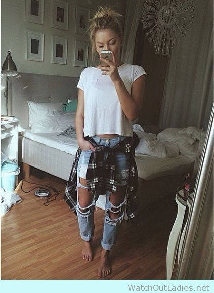 Try this outfit this summer, ripped jeans and plaid shirt around waist
