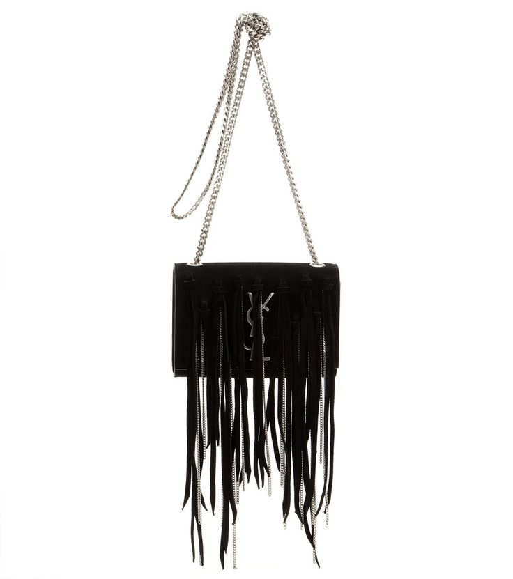 Saint Laurent - Monogram Small embellished fringed suede shoulder bag - Saint Laurent takes its 'Monogram' shoulder bag and piles on layers of fringe and chunky chains for a rocker-chic effect that embodies the look shown on the runway this season. The black suede base keeps the look classic and lets the details stand out. Carry it over your shoulder as part of a monochromatic look. seen @ www.mytheresa.com