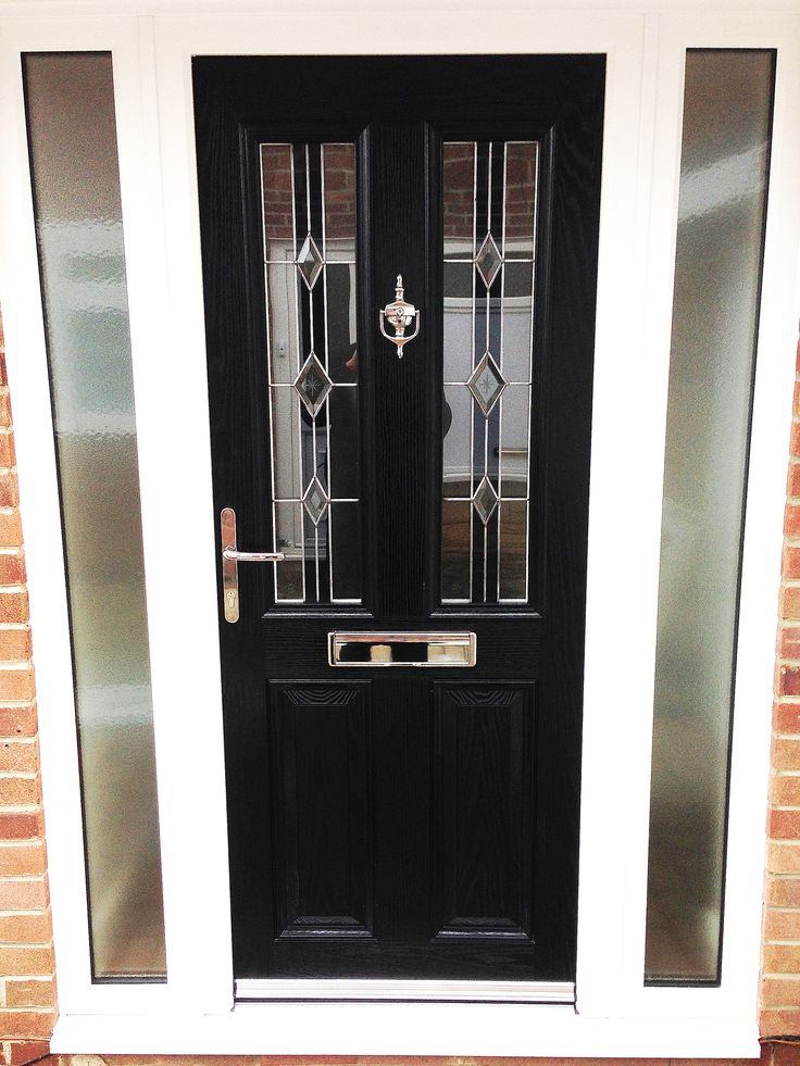 The popular Black Altmore Composite Door, with White UPVC Side panels, comprising of Rehau profile. The Glass design is the modern Ebony Diamond, finished off with chrome Fixtures and Fittings.