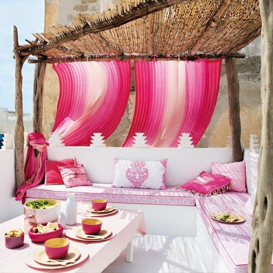Bright pink and white outdoor deck area...