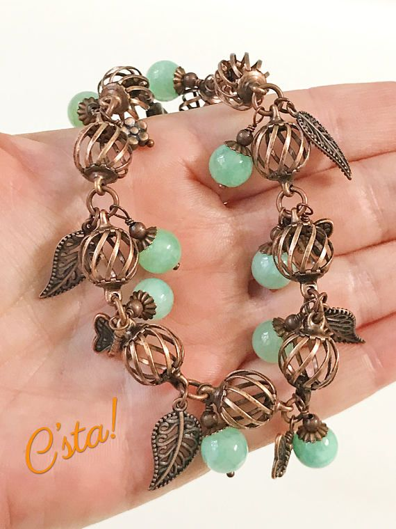 Aqua Blue Charm Bracelet • Gemstone: Aqua Blue Quartzite • Charms: Butterflies, Leaves, Flowers. • Metal: Antiqued Copper Components - All components have a permanent baked on lacquer finish and will not change in color nor turn your skin green. • Bracelet Width: 3/8. • Length: This bracelet fits a size 6 1/2 wrist perfectly but will accommodate larger sizes beautifully. It is 8 long with a 2 extender. All sizes are approximate. Click zoom for better detail! Woo-hoo! Co...