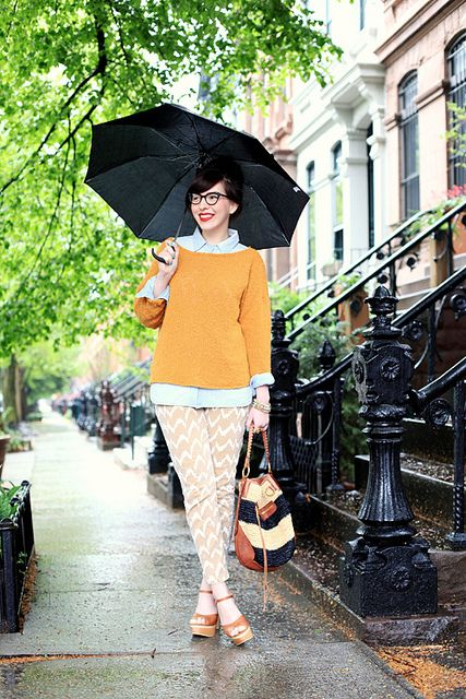 Love everything about this: the printed pants, the orange sweater and chambray shirt, the red lips, the shoes, and of course, the umbrella.