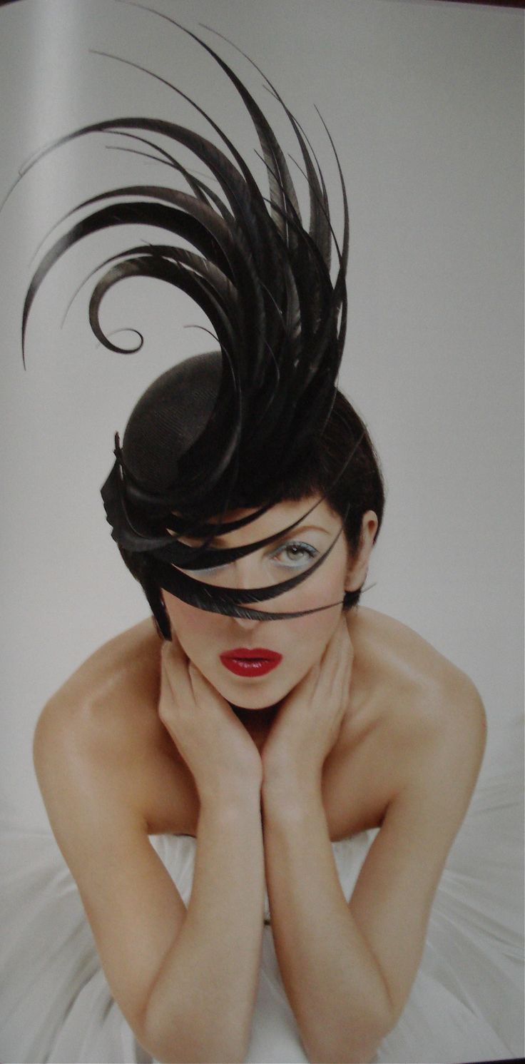 "1996. Isabella Blow in a hat by Philip Treacy.  This photo is on the front cover of the book ""Blow by Blow: The Story of Isabella Blow"""