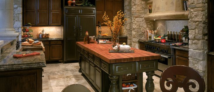 This kitchen remodel involved everything AND the Kitchen sink of course! From the beam ceiling, to the stone columns and farm house sink this Kitchen now has it all. A blend of traditional and Mediterranean styles.  Jaurgui Architecture Interior Construction and J. Myers & Associates / Texas