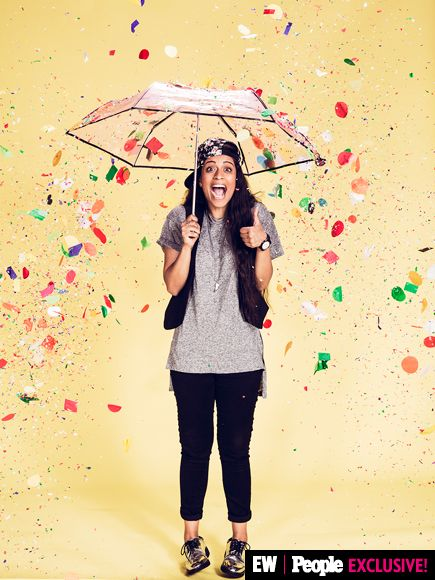 Lilly Singh (a.k.a. Superwoman) was prepared for rain confetti inside the PEOPLE/EW #VidCon booth.   Image Credit: Ramona Rosales/People/EW
