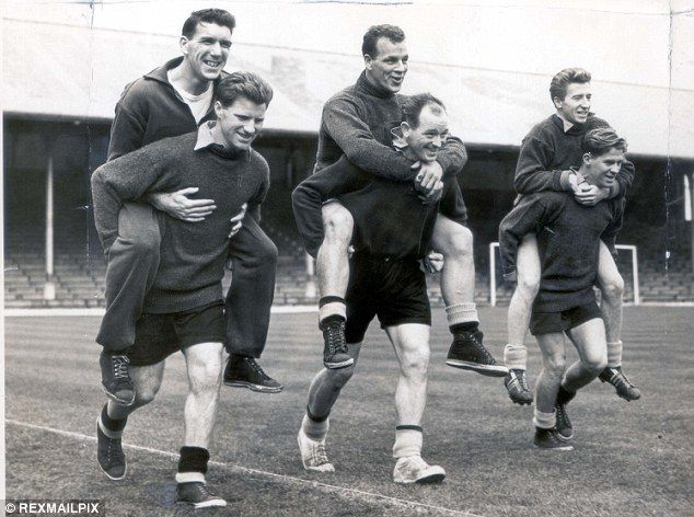 Giving them a lift : Wales players (from left) Stuart Williams, John Charles (Wales, 1950–1965, 38 caps, 15 goals) and Cliff Jones on the backs of Derek Sullivan, Alf Sherwood and Noel Kinsey in training before a match against England in 1955.