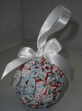 Christmas ornament made with yo-yo's, pearls and ribbon, and Styrofoam ball.