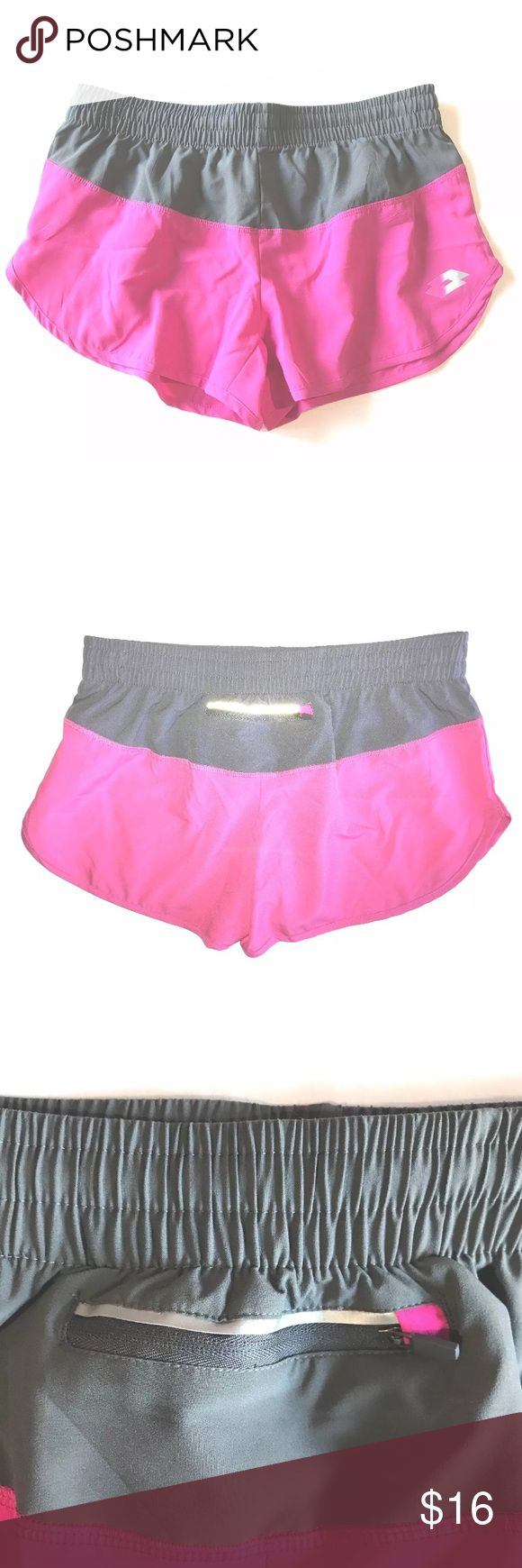 "NEW Lotto X-Dry Women's Running Shorts NEW Lotto X-Dry Soft Women's Running Shorts Pink & Gray SIZE Large   	•	Thin, lightweight running shorts 	•	Stretch waistband, with inside drawstring 	•	Small back key pocket 	•	Size: Large 	•	Waist: 30 inches around unstretched 	•	3"" inseam 	•	100% Polyester  Thank you so much! Lotto Shorts"