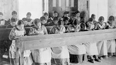 Native children were sent to residential boarding schools, like this one in Fort Resolution, N.W.T., in late 19th and early 20th centuries. Early versions of the Indian Act were clearly designed to assimilate First Nations people. (Library and Archives Canada/PA-042133)