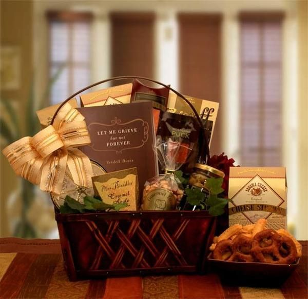 Sympathy & Condolence Gift Baskets,Loved ones,Love losing a loved one,Inspirational book. During this difficult time of loss let them know they are remembered by you. This elegant gourmet gift basket is filled with small gourmet items to nibble when the time is right and a thoughtful inspirations Sympathy book. Includes: a dark stained wooden basket, Let Me Grieve book with inspirational thoughts and stories for those grieving. What's inside this Gift Basket? The A Time To Grieve Sympathy…