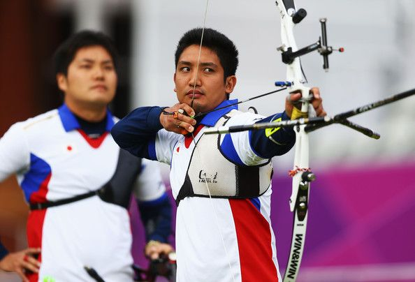 Yu Ishizu of Japan in action in the men's Team Archery Eliminations match between Japan and India on Day 1 of the London 2012 Olympic Games at Lord's Cricket Ground on July 28, 2012 in London, England.