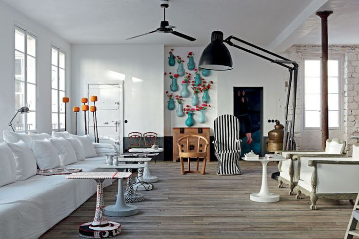 <p>Inspired by her travels, my new favorite interior designer Paola Navone made her Paris apartment feel like an eclectic summer country house. The bathroom and master bedroom invoke the Mediterranean
