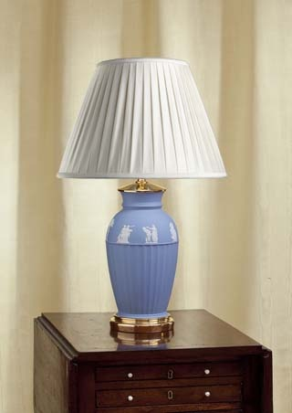 """A vintage Wedgwood, pale blue, jasper lamp.   The lamp of classic style,    the upper third decorated with white jasper bas-reliefs  of subjects derived from classical Greek art. The lamp seated in a custom made, gold plated bronze base,   the custom made lamp cap of gold plated bronze.  The combination of the pale blue and white jasper   combined with the gold plated bronze,  producing a  formal lamp in classic style.      Circa 1960     Overall height (including shade) 20""""/51cm"""