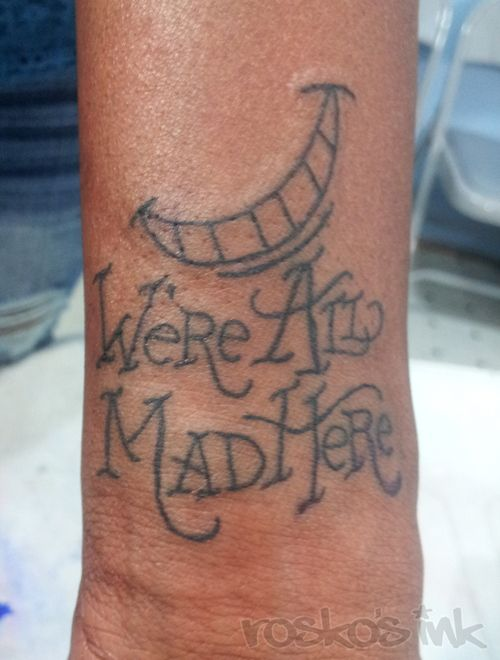 We're All Made Here Cheshire Cat Smile Tattoo
