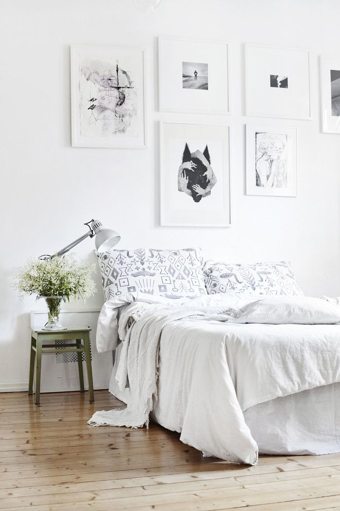 Love the picture wall and muted navajo bed linen! The Design Chaser