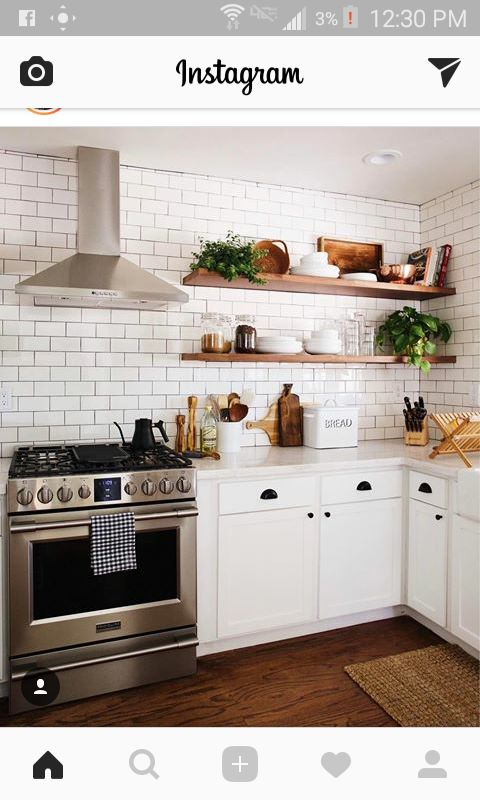 Exposed wood shelves with white cabinets