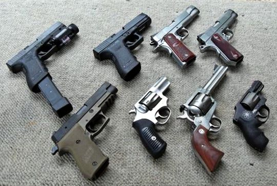 An assortment of handguns.