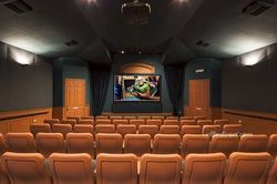 Take in a movie at the Clubhouse Movie Theater in Windsor Palms Resort, Kissimmee, Florida.