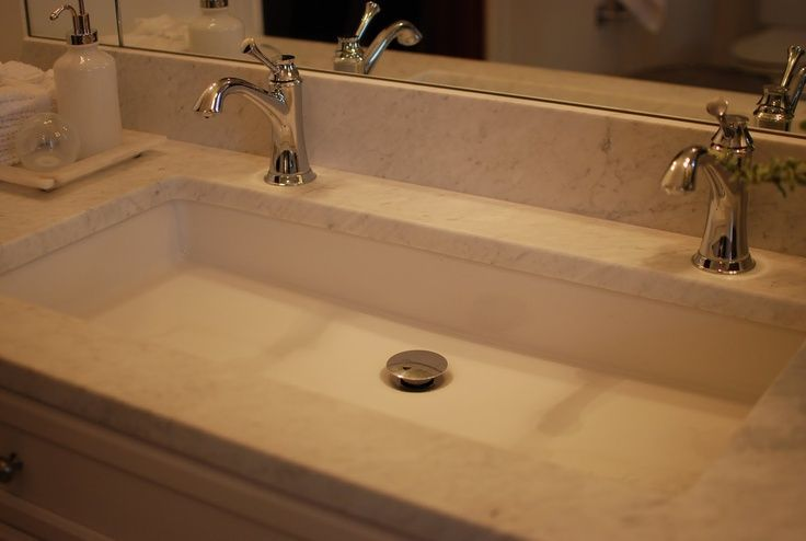 Undermount long sink with two faucets.  Nice solution for small bathroom.