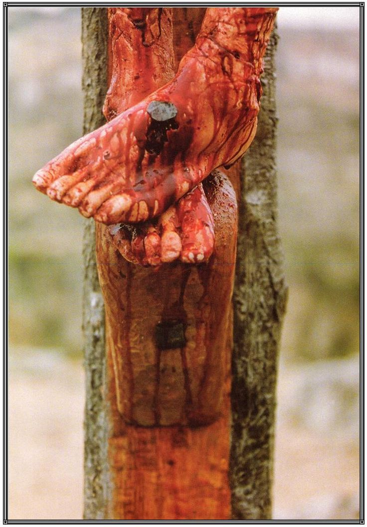 the passion of the christ | action is carried out the other side next the feet