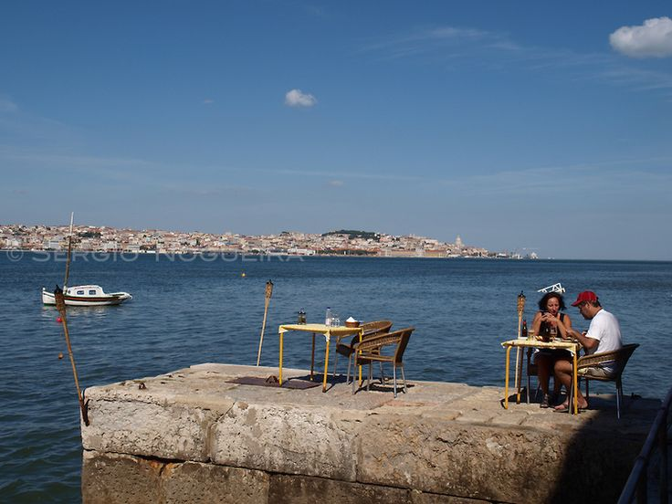 lunch by the #tagus river with #lisbon in background Sergio Nogueira - Photography