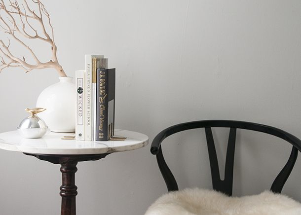 Sweet little setup // Bookends // Gold: Side Table, Sweet, Lucite Bookend, Vignette