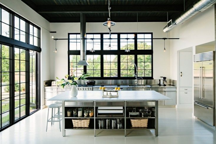 Industrial Portland Loft | Remodelista: Black window frames + White walls.