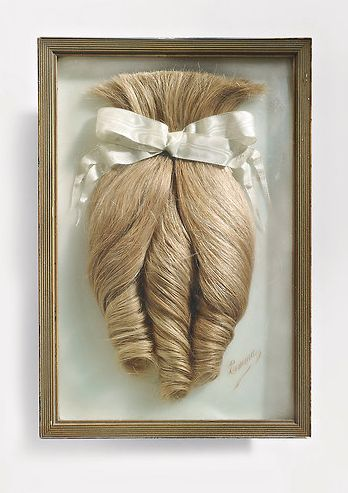 Hairpiece cut from a young woman named Emma when she entered the Carmelite order.  (Circa 1900)  André Malraux bought the object at a Paris flea market and gave it to a friend for his twentieth birthday.  Credit: Collection Jean-Jacques Lebel.