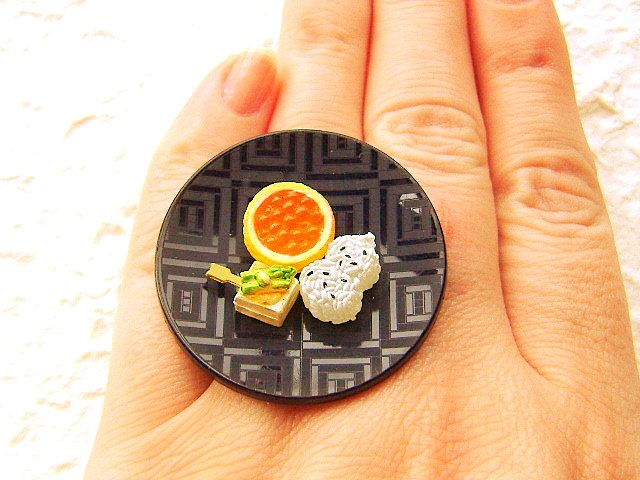 If you want your jewelry to really stand out (and you are hungry for a snack), check out this cute & quirky mini-food jewelry by SouZouCreations. Souzou, meaning 'creation through imagination,' is an Etsy shop that was started by Canadian artist Sofia. Sofia currently lives in Japan and creates these deliciously sweet accessories with combinations of wood, Japanese chiyogami paper, pottery shards, and small plastic food pieces.