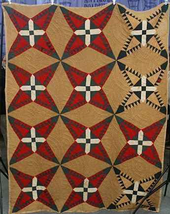 African American Quilt, ca. 1830, rare, purchased from the Polk estate (Georgia). Made by a slave, incorporating an African motif - representing the Chango deity - and colors.  Posted at Antiques Roadshow on PBS