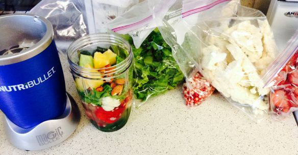My Weight Loss NutriBullet Recipe ~ I added the following: Frozen Spinach, Frozen Strawberries, Butter Lettuce, Pomegranate seeds, Cauliflower, Pineapple, Pineapple Juice, Water, and Almonds. I blended it all for about 30 seconds and it came out delicious! It does look like something the lawn mower would cough up, but its healthy and tasty.