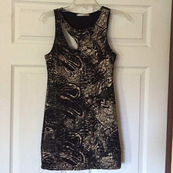 Night Out Dress Stretchy form fitting animal print dress. Asymmetric cutouts. Easel Dresses Mini