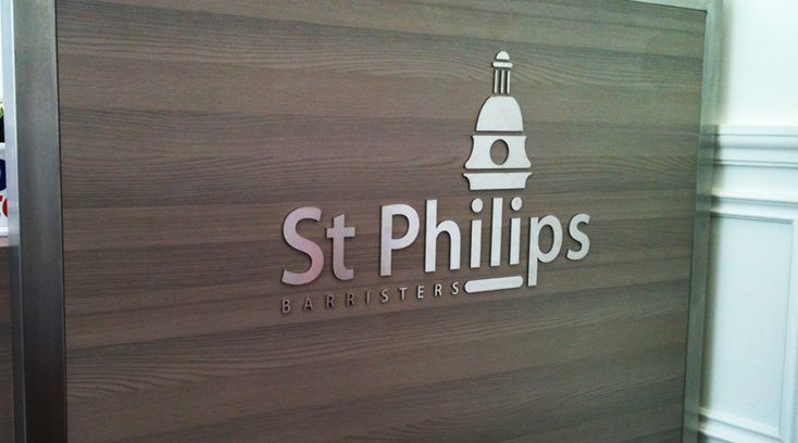 St Phillips stainless steel logo installed to wall by Space3.co.uk
