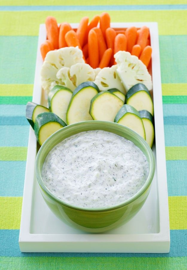 This delicious Ranch Cucumber Dip recipe goes great with all kinds of veggies -- we especially love it with cauliflower and carrots!
