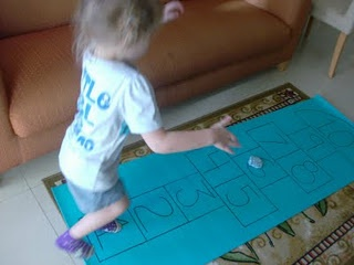 Indoor hopscotch with a yoga mat - great for counting
