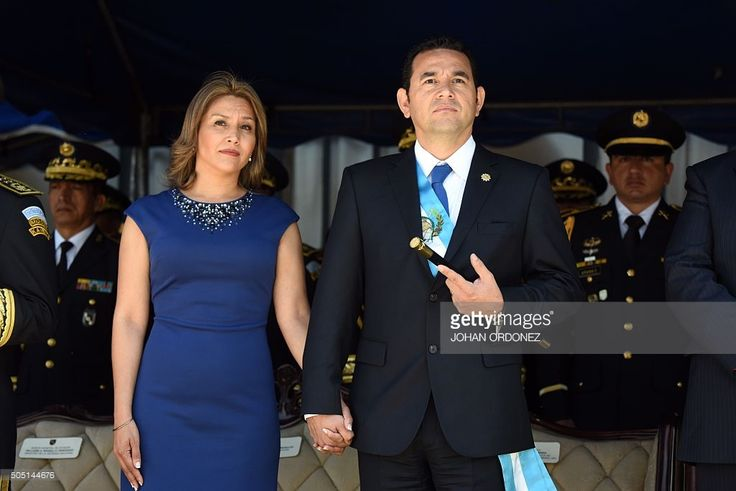 Guatemalan President and Army Commander in Chief Jimmy Morales stands next to his wife Gilda Marroquin during a ceremony at Campo Marte in Guatemala City, on January 15, 2016. Morales, a former TV comic elected on a wave of public revulsion against widespread graft, took office Thursday, January 14. AFP PHOTO/Johan ORDONEZ / AFP / JOHAN
