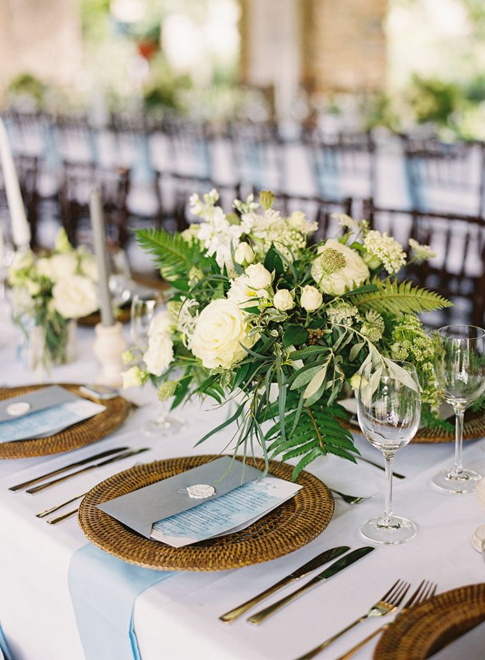 Woven Chargers with Fresh Greenery Centerpieces  https://heyweddinglady.com/best-day-ever-fairy-tale-destination-wedding/    #realwedding#weddingday#realbride#destinationwedding#travel#fairytale#wedding#weddinginspiration#weddingreception #centerpiece #weddingflowers #weddingdecor