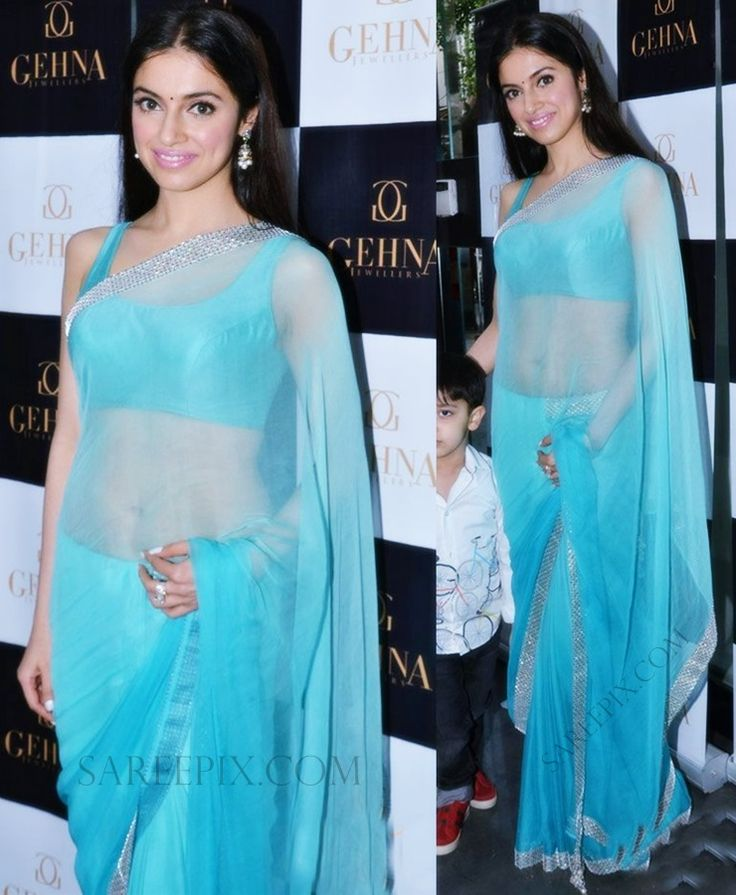 Bollywood celeb Divya khosla in transparent saree at Gehna jewellers event. She was eye catchy in light blue tissue saree with sleeveless matching blouse.