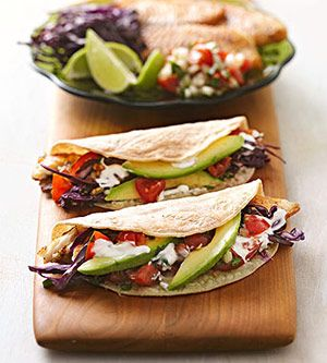 Tilapia Tacos - Mild flaky fish, colorful slaw, avocado and a creamy greek yogurt lime juice sauce all wrapped in a toasty whole grain tortilla