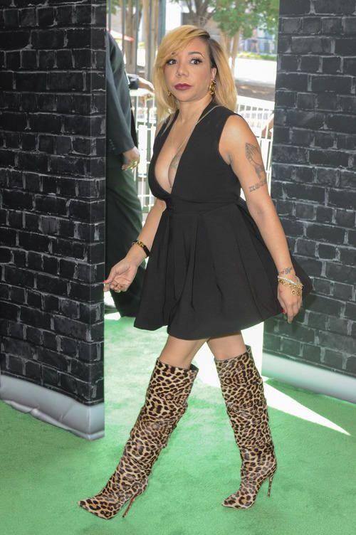 Tameka Harris at the 2014 BET Hip Hop Awards wearing knee high leopard print boots