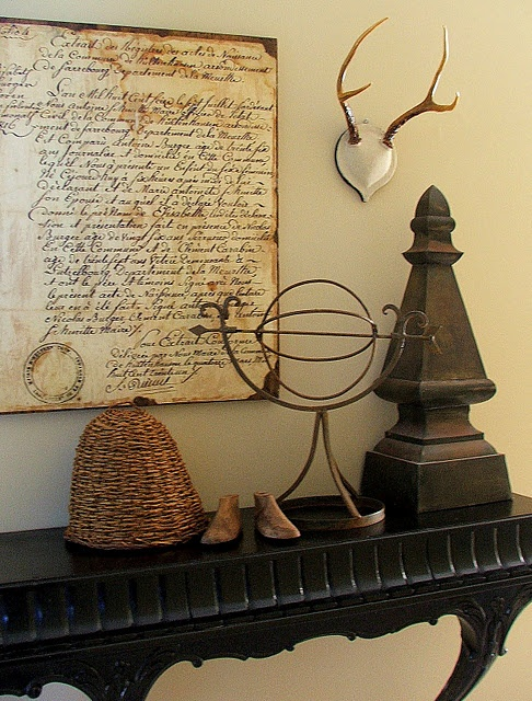 a beautiful vignette of antique items...
