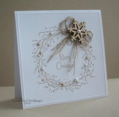I love the simplicity of this card and the gold and neutral colors on white. The Blossom Circle makes a lovely Christmas wreath on this handmade card.